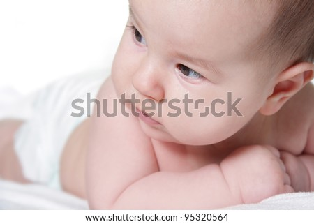 close up portrait of cute baby over white