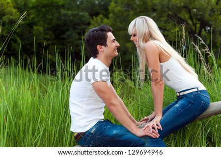 Close up portrait of cute couple on date in park. - stock photo