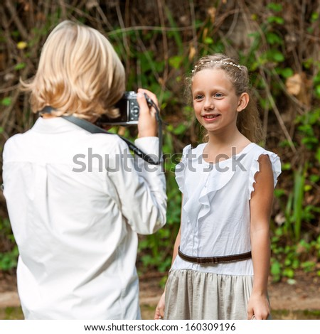 Close up portrait of cute girl posing at camera outdoors. - stock photo