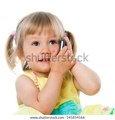 Close up portrait of cute little girl talking on cell phone.Isolated on white. - stock photo