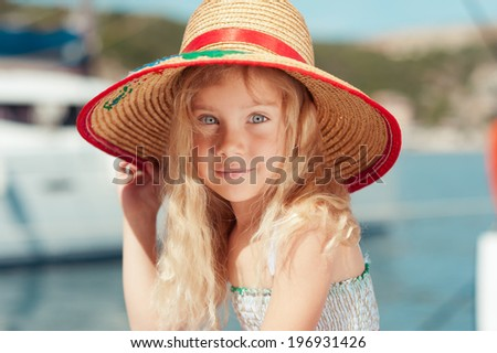 Close up portrait of cute little girl wearing hat - stock photo