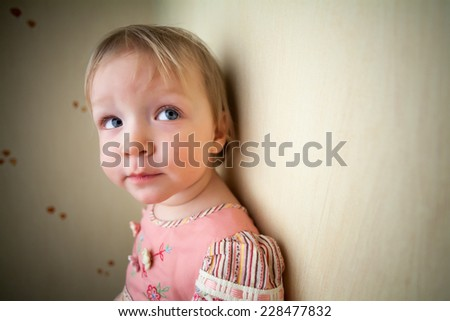 Close-up portrait of cute pensive girl - stock photo