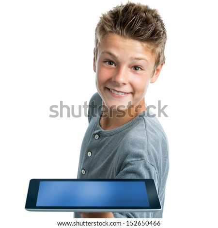 Close up portrait of cute teen boy showing blank tablet.Isolated on white background. - stock photo