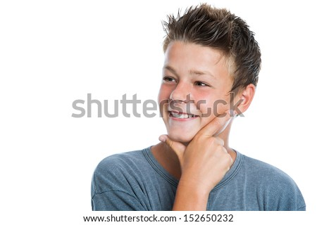 Close up portrait of cute teen looking aside with hand on chin. Isolated on white background.