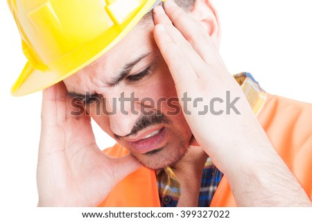 Close-up portrait of depressed constructor holding his head with hands as sorrow and migraine concept isolated on white background - stock photo