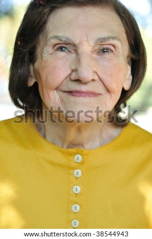 Close-up portrait of  eighty-something senior woman - stock photo