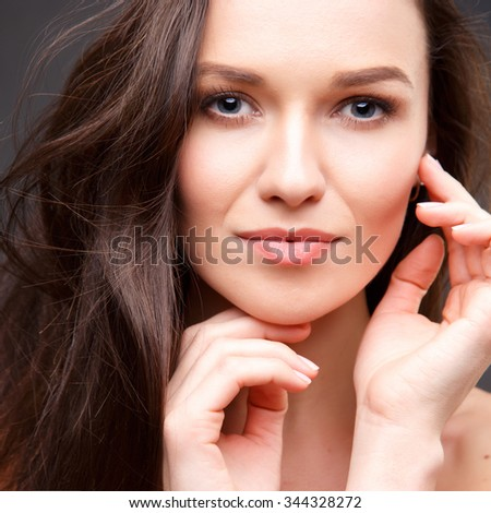 Close up portrait of elegant brunette woman with nude make up - stock photo