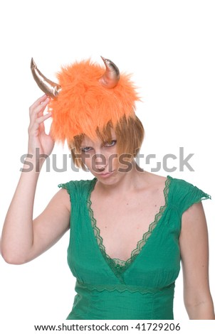 Close up portrait of emotional girl in green dress with orange cow mask