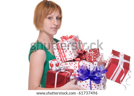 Close up portrait of emotional girl in green dress with some gifts - stock photo