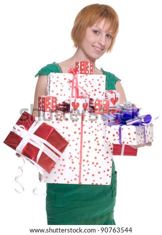 Close up portrait of emotional woman in green dress with some gifts box - stock photo
