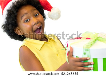 Close up portrait of exited little african kid holding if christmas gift.Isolated on white background.