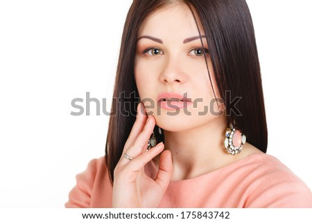 Close-up portrait of fashionable lady wearing luxury golden jewelery. Young attractive Caucasian woman model posing in studio. - stock photo
