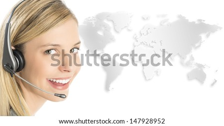 Close-up portrait of female customer service representative wearing headset with world map against white background - stock photo