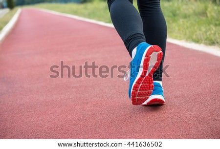 Close up portrait of female runner legs at stadium