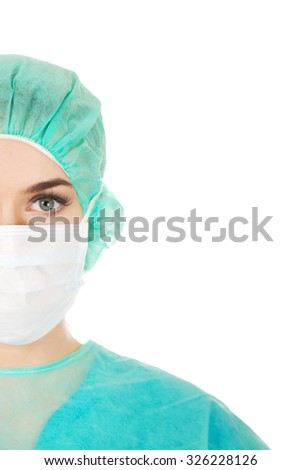 Close-up portrait of female surgeon doctor in mask.