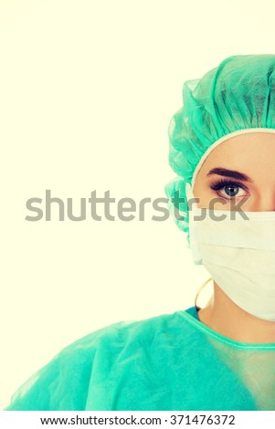 Close-up portrait of female surgeon doctor in mask