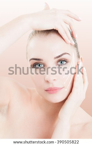 Close-up portrait of female with perfect skin ready for cosmetic surgery to prevent wrinkles against pink studio background - stock photo