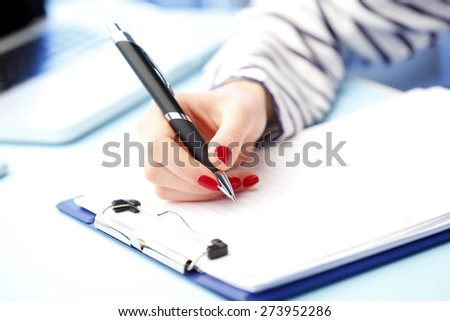 Close-up portrait of financial administrator sitting at office while signing the contract.  - stock photo