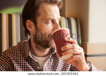 Close up portrait of forty years old caucasian man in casual outfit drinking coffee in a cafe - city lifestyle. - stock photo