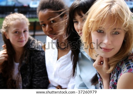 Close-up portrait of four urban women outside