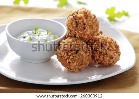 close up portrait of fried crispy zucchini and feta balls - stock photo