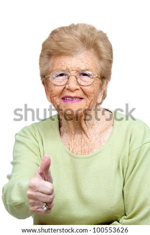 Close up portrait of friendly senior woman showing thumbs up.Isolated on white.