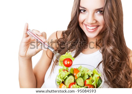 close-up portrait of funny happy smiling girl with salad on white background - stock photo