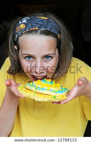 close-up portrait of girl eating biscuit - stock photo