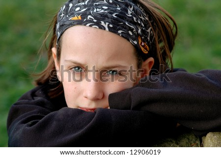 close-up portrait of girl looking fed up - stock photo