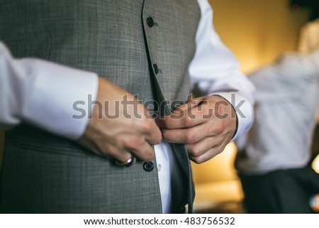 Close Up Portrait of Groom Getting Ready with Perfect Natural Light