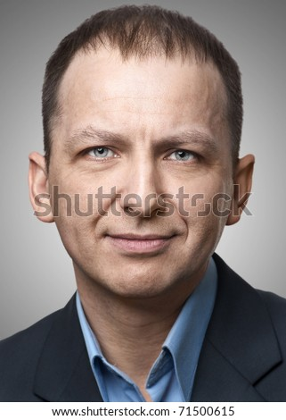 Close-up portrait of handsome man looking at camera - stock photo