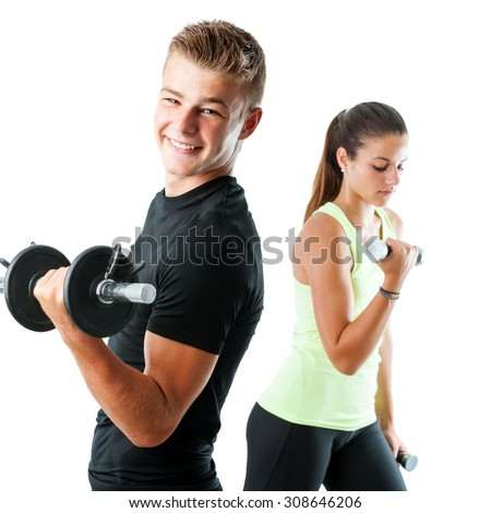 Close up portrait of handsome teen boy working out with weights.Out of focus girl working out in background.Isolated on white. - stock photo