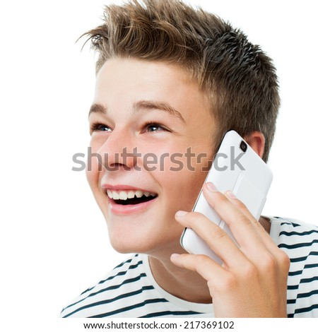 Close up portrait of Handsome teen talking on smart phone.Isolated on white background. - stock photo