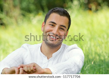 Close-up portrait of handsome young man, outdoor - stock photo