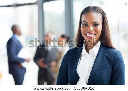 close up portrait of happy african american businesswoman - stock photo