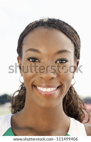 Close-up portrait of happy African American female athlete smiling - stock photo