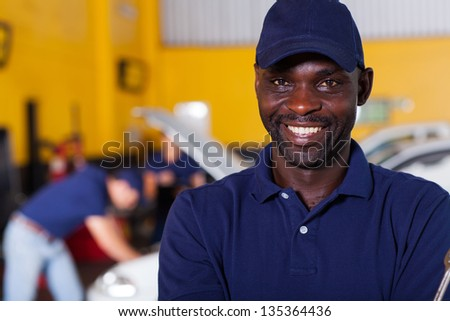 close up portrait of happy african male auto mechanic - stock photo