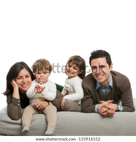 Close up portrait of happy family relaxing on couch.Isolated. - stock photo
