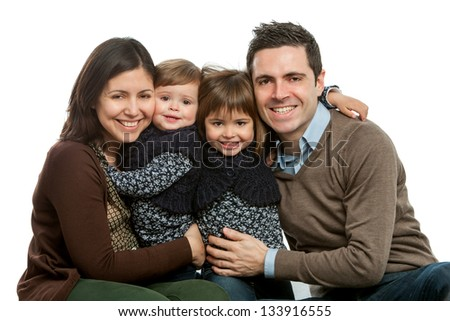 Close up portrait of happy family with heads together.Isolated on white.
