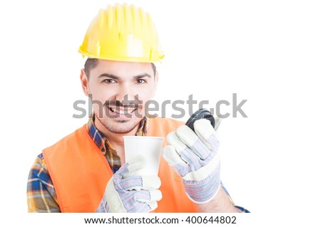 Close-up portrait of happy handsome engineer with a cup of coffee in his break isolated on white background
