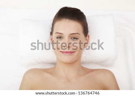 Close-up portrait of happy lady relaxing in massage salon - stock photo