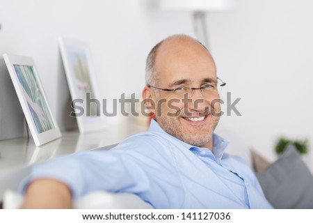 Close up portrait of happy mature man indoors - stock photo