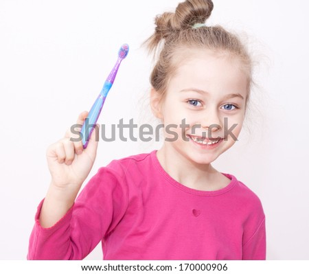 Of happy smiling five years old caucasian blond child girl in pyjamas
