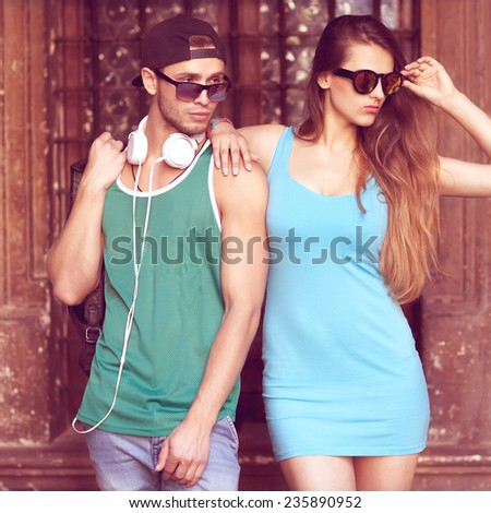 Close up portrait of happy smiling hipster couple in love. Wearing retro clothes and sunglasses. Fashion. Vogue.
