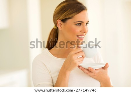 close up portrait of happy woman drinking coffee