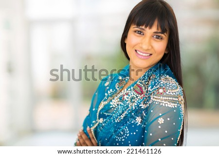 close up portrait of happy young indian woman - stock photo