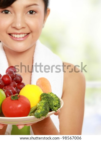 close up portrait of healthy fitness woman carrying a group of healthy food - stock photo