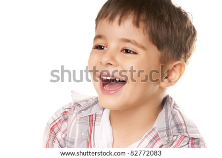 Close-up portrait of joyful happy little boy on white background - stock photo