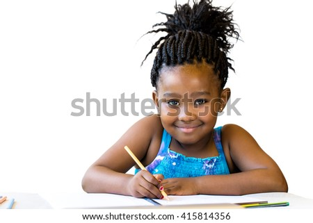 Close up portrait of little african girl holding color pencil at desk.Isolated on white background. - stock photo