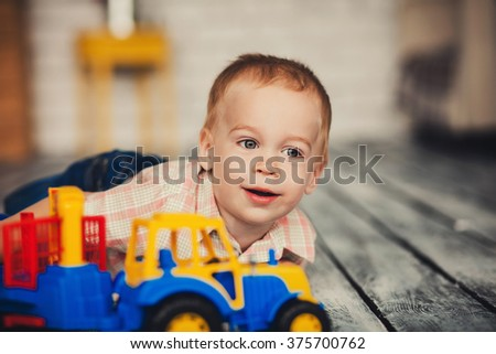 close-up portrait of little boy with bright toys